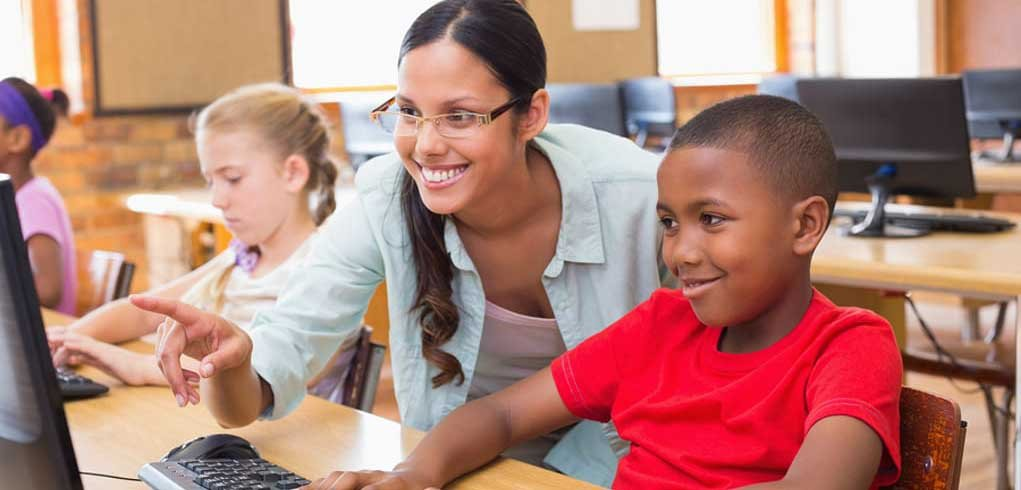 Teacher-providing-student-with-personalized-learning-at-a-computer-Feature-Image